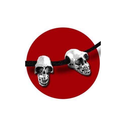 Set 2 décorations de crânes argentés